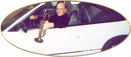 Dave in the car with trumpet
